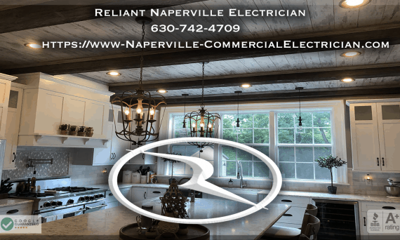 A screen shot of Reliant Naperville Electricians homepage showing a white Reliant logo in the center and white contact information with a kitchen background image.